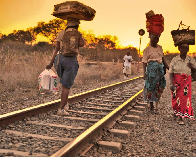 Women traders walking along railroad tracks from Zimbabwe to Zambia